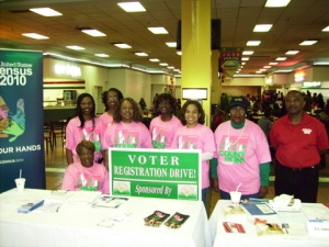 Soror Thetus Knox was serious about getting our community registered to vote. She's holding the sign on the left.